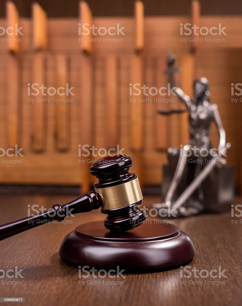Wooden gavel on wooden table, law concept stock photo