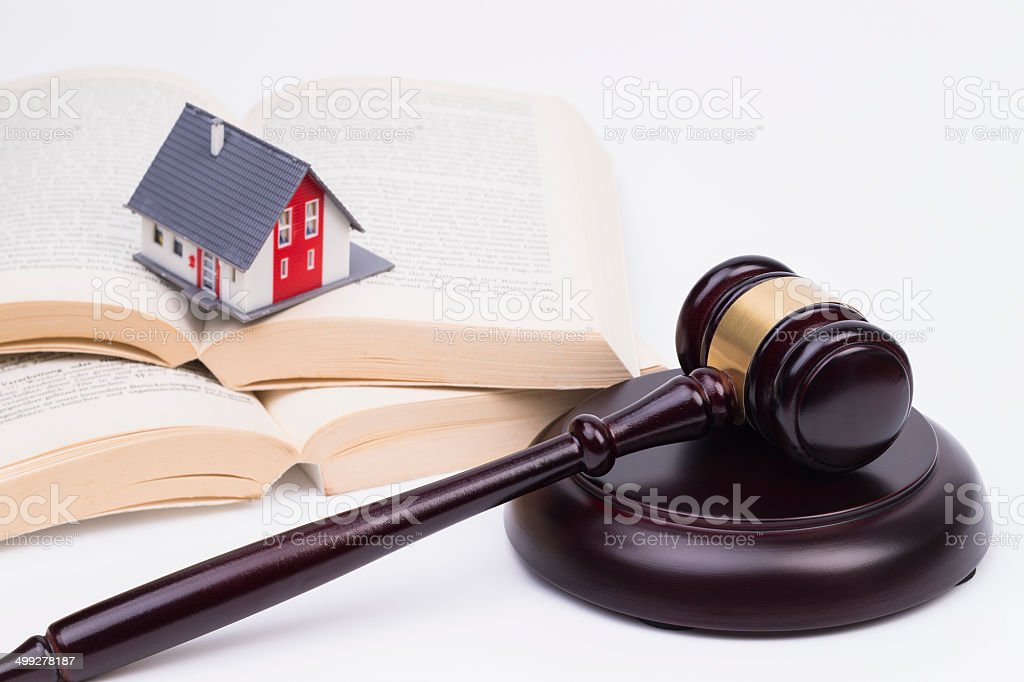 Wooden gavel with house stock photo