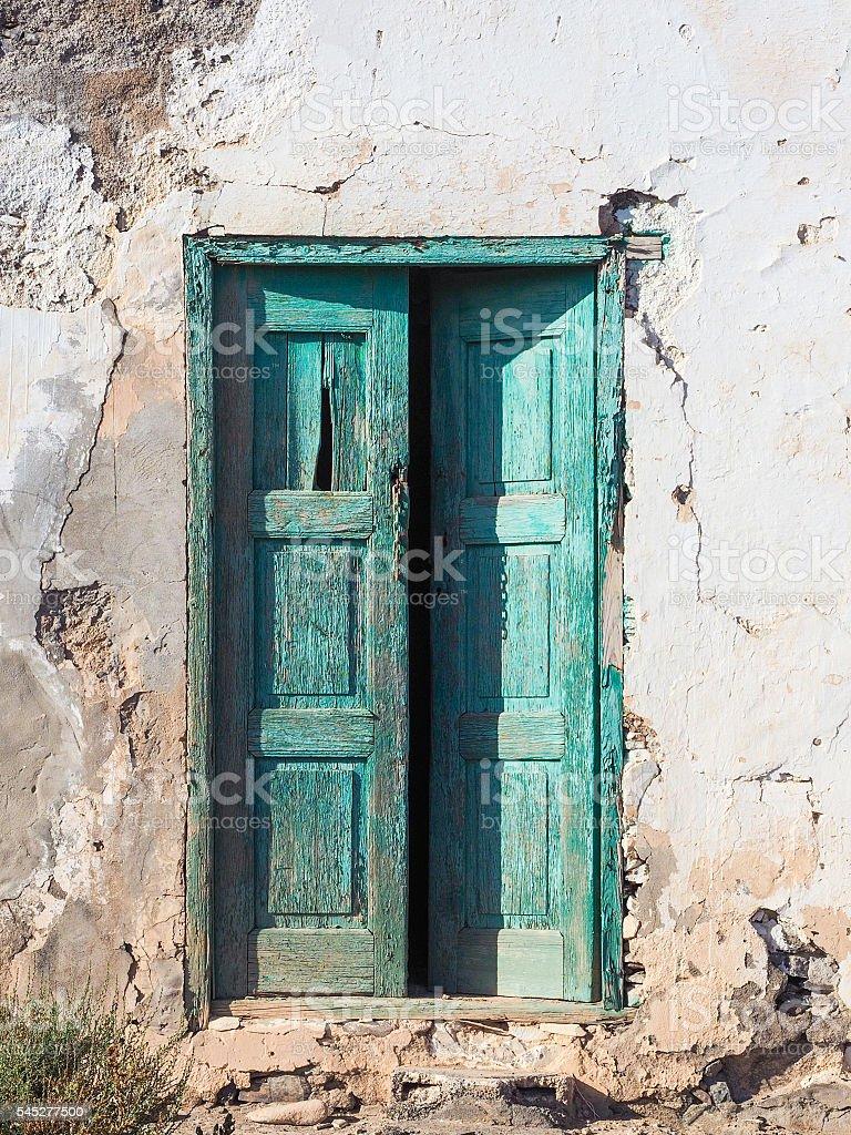 Wooden green door in a rotten house stock photo