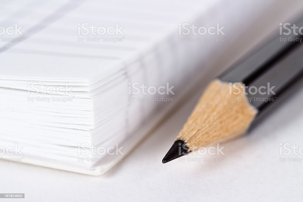 Wooden grey pencil near opened notepad royalty-free stock photo