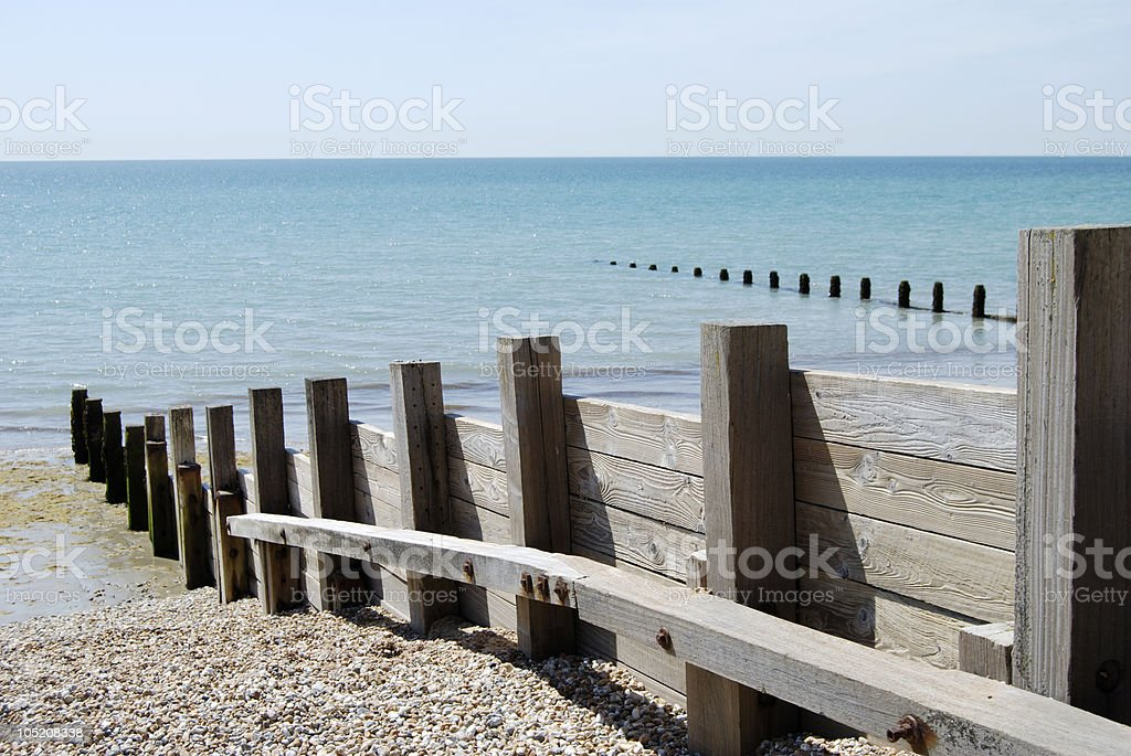 Wooden groyne on shingle beach. Bognor Regis. England stock photo