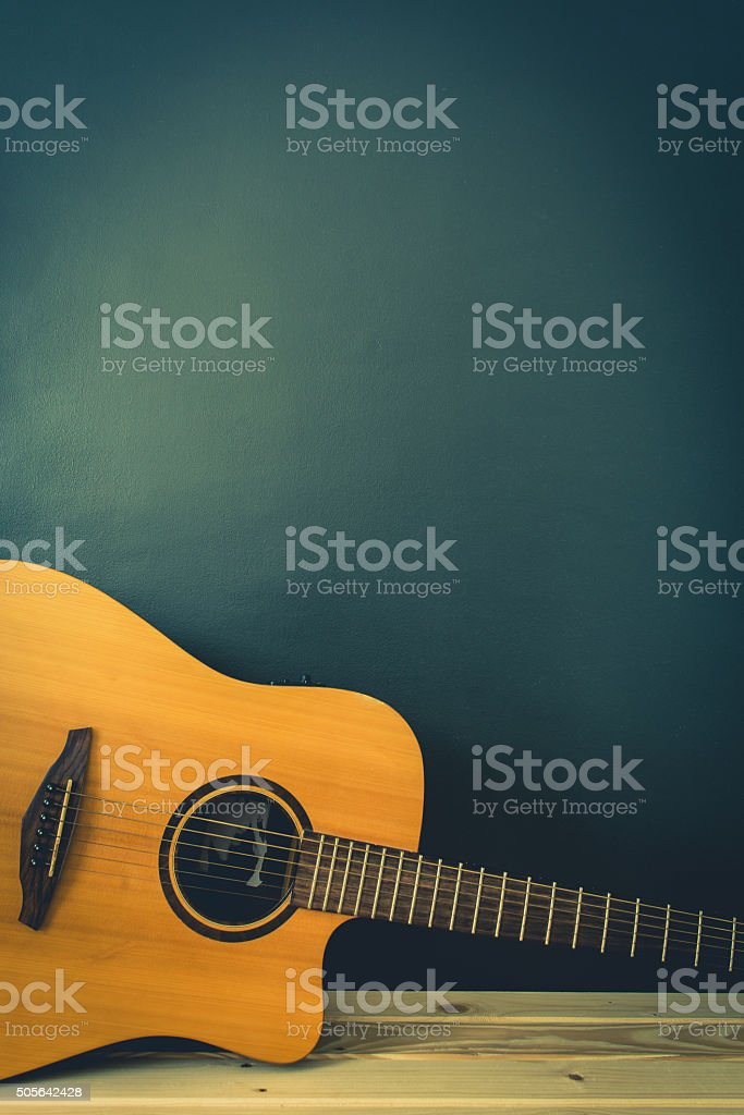 wooden guitar stock photo