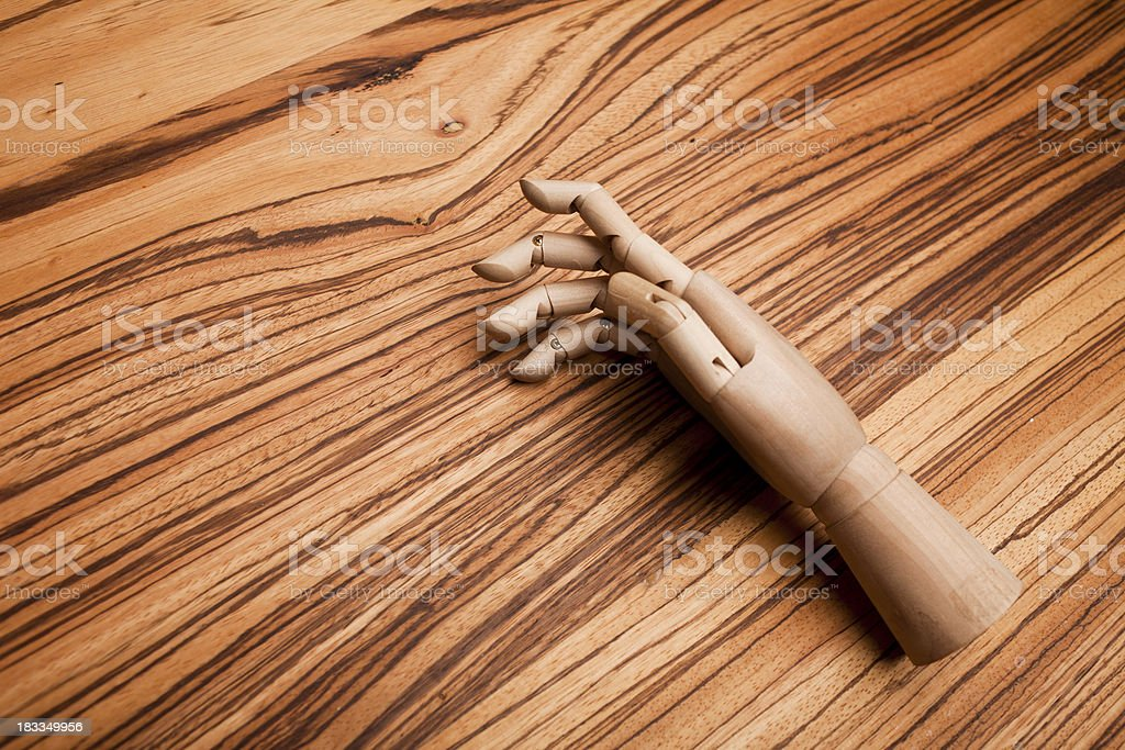wooden hand on a table stock photo