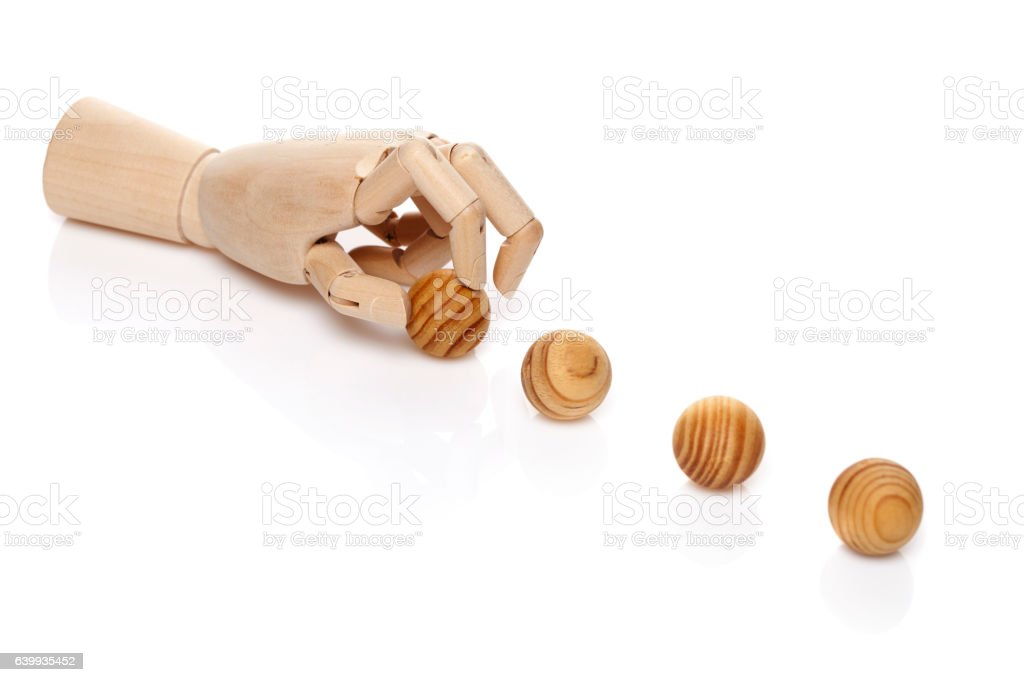 Wooden hand with balls stock photo