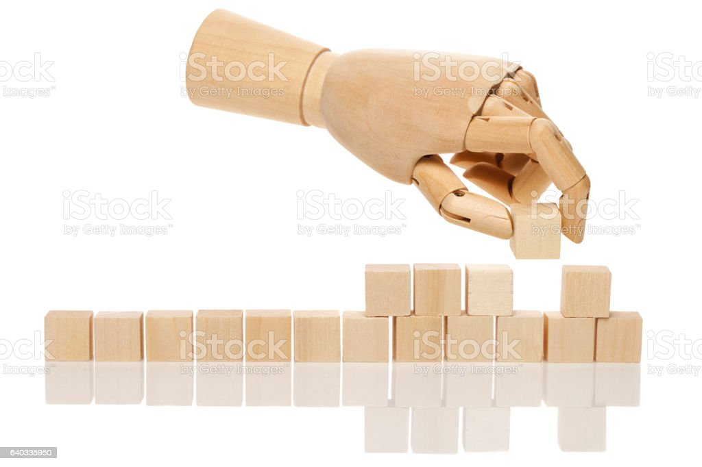 Wooden hand with cubes stock photo