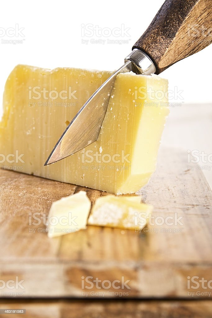 wooden handle knife and parmesan cheese stock photo