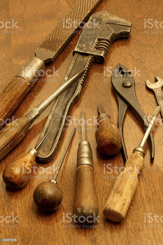 Wooden Handled tools awl wrench pliers screwdriver file rasp royalty-free stock photo