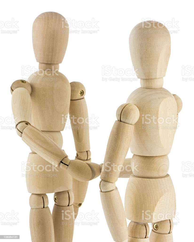 Wooden Handshake on white background royalty-free stock photo