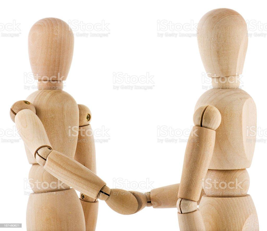 Wooden Handshake on white background stock photo