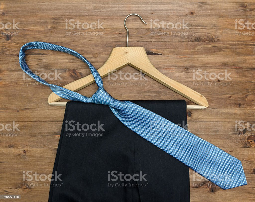 wooden hanger with  tie and trousers stock photo