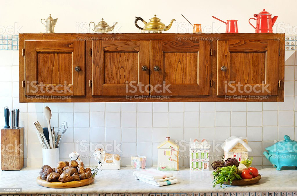 Wooden hanging cupboard on white tiles, rustic kitchen. stock photo