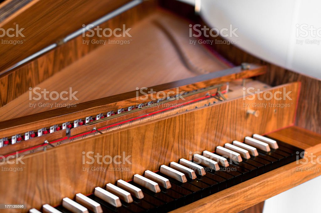 Wooden harpsichord keyboard with black keys stock photo