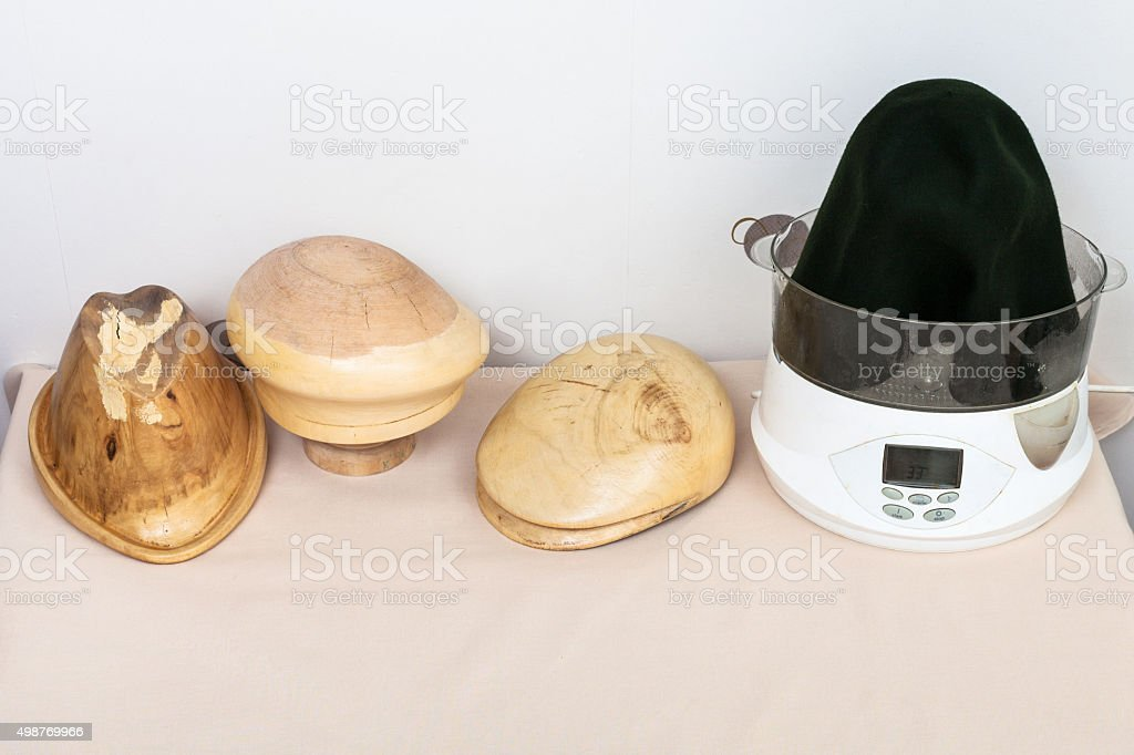wooden hat-blocks made for shaping of felt hats stock photo