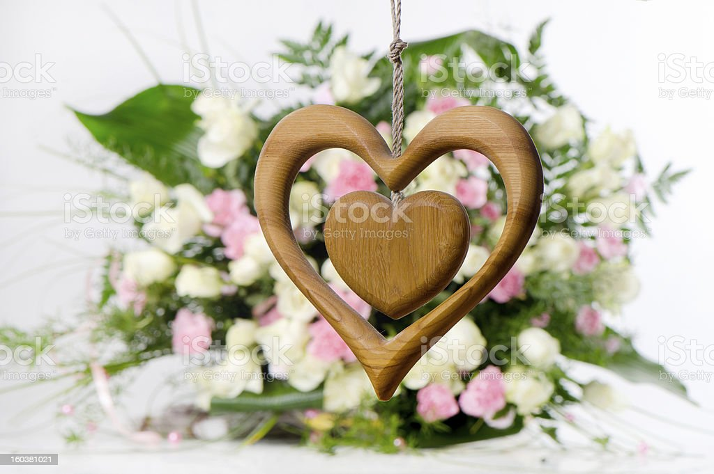 Wooden heart on flower background royalty-free stock photo