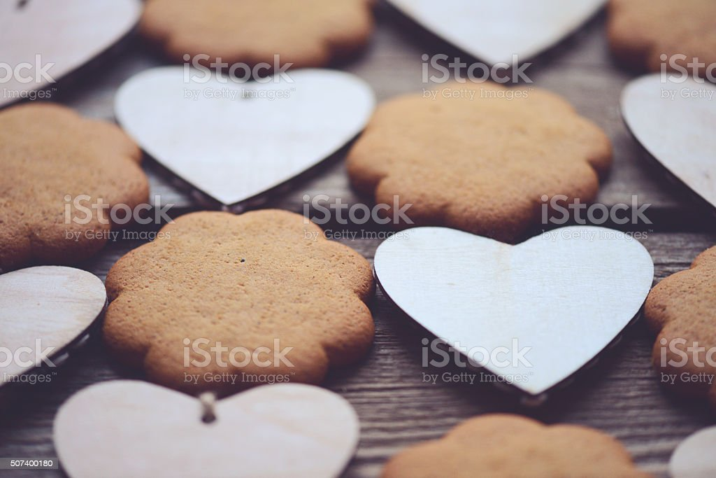 wooden hearts and ginger biscuits stock photo