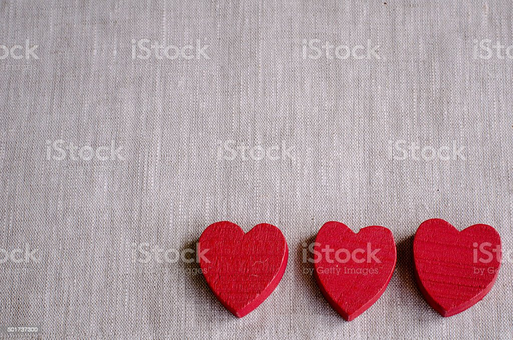Wooden hearts on canvas stock photo