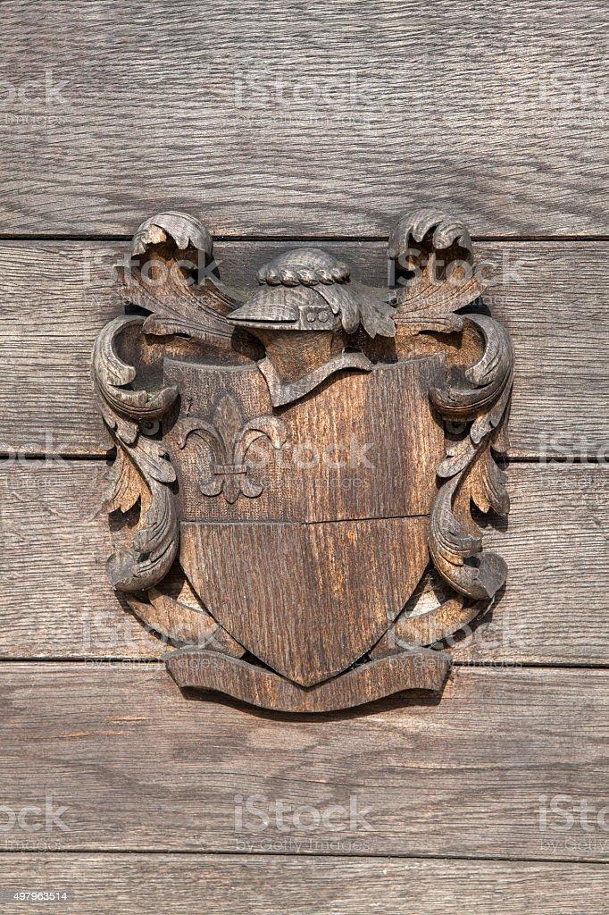 Wooden heraldic shield stock photo