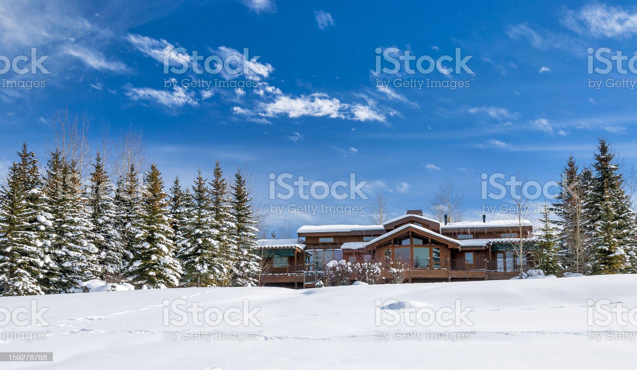 Wooden hounse in the snow winter Idaho royalty-free stock photo