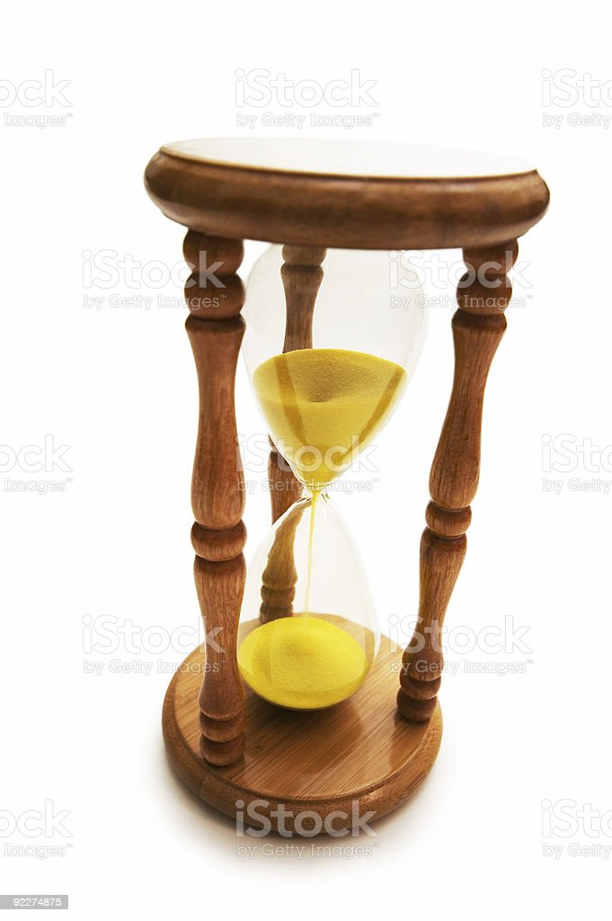Wooden hourglass isolated on the white background royalty-free stock photo