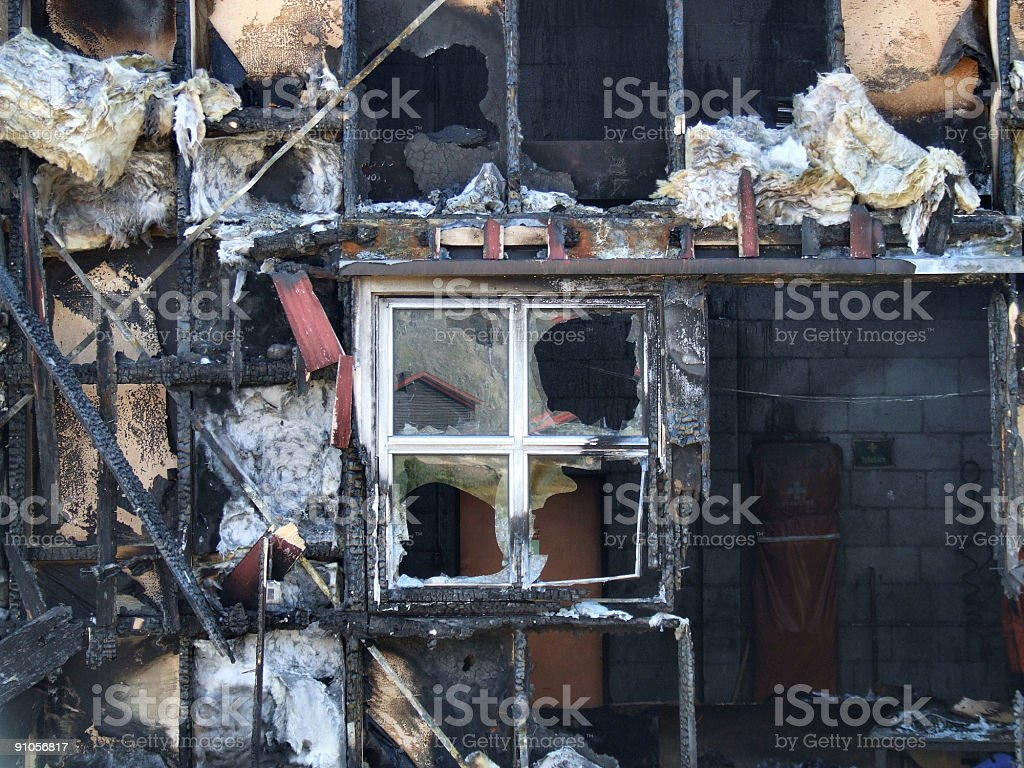 Wooden house after fire royalty-free stock photo