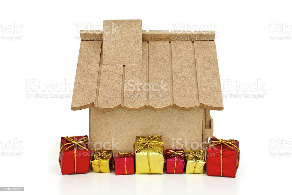 Wooden house and gifts royalty-free stock photo