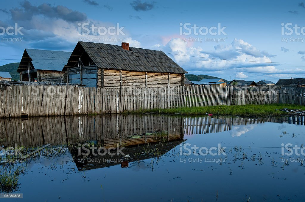 Wooden house and its reflections in pond stock photo