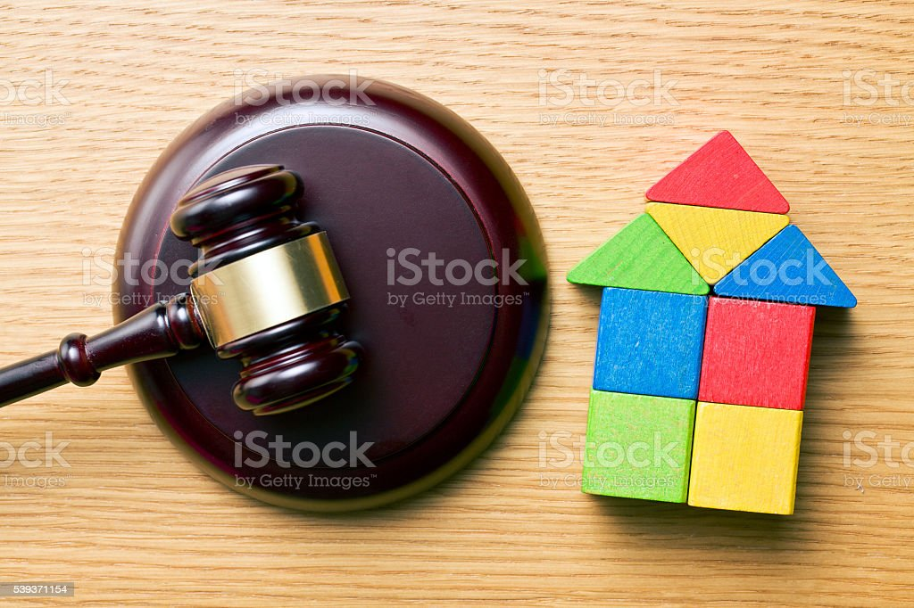wooden house and judge gavel stock photo