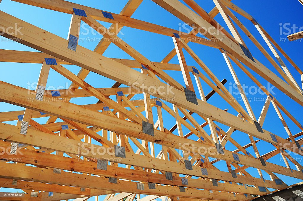Wooden house construction detail in blue sunny day sky stock photo