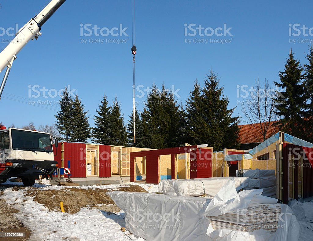 wooden house construction in sunny ambiance stock photo