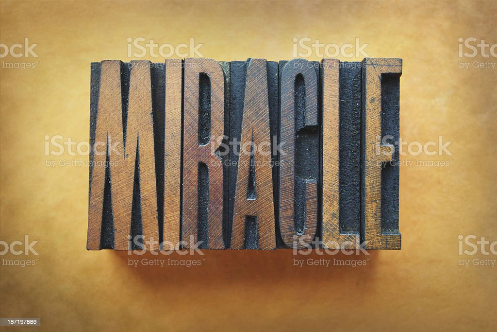 Wooden house decoration of word miracle stock photo