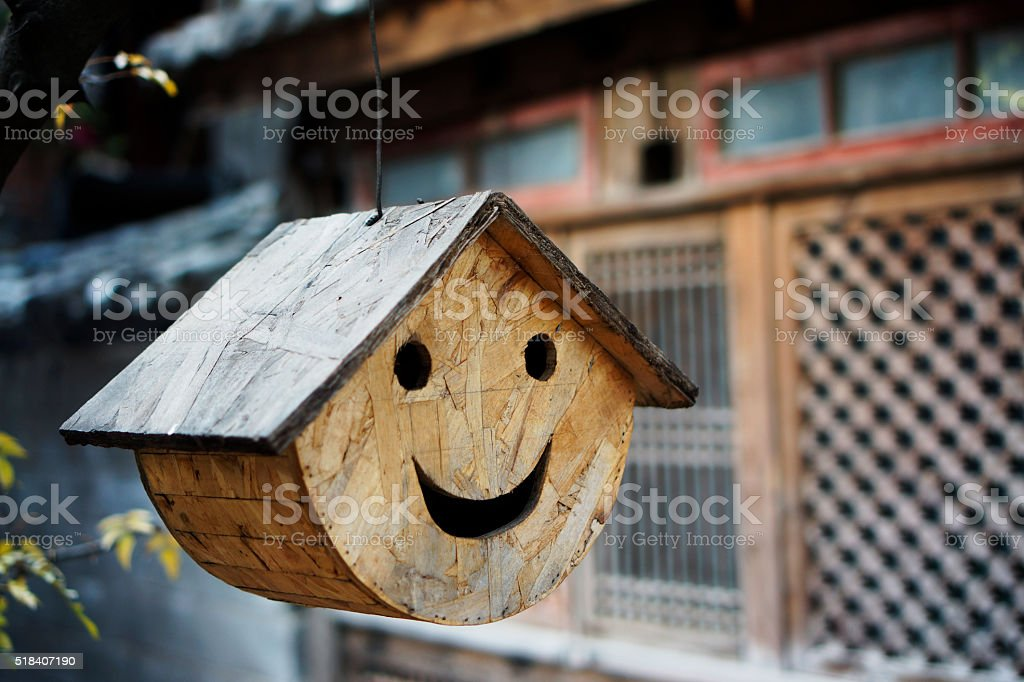 wooden house for bird,hanging on tree stock photo