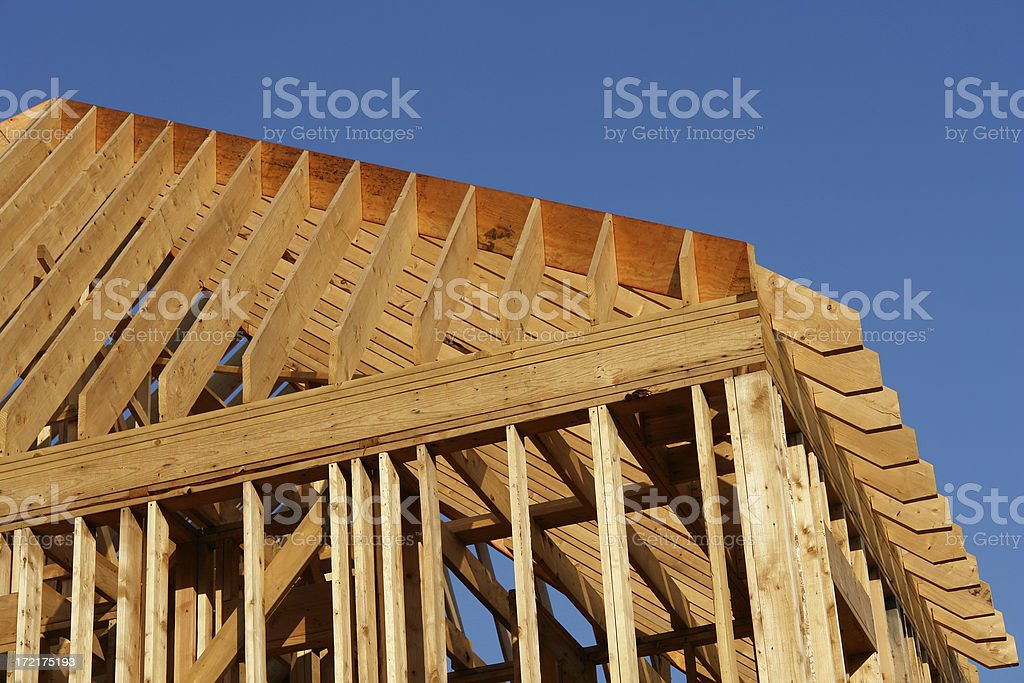 wooden house frame against blue sky royalty-free stock photo