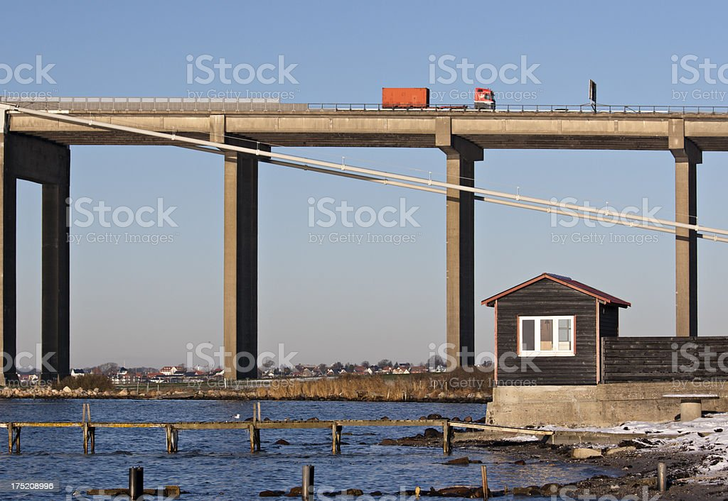 Wooden house in front of The New Little Belt Bridge stock photo