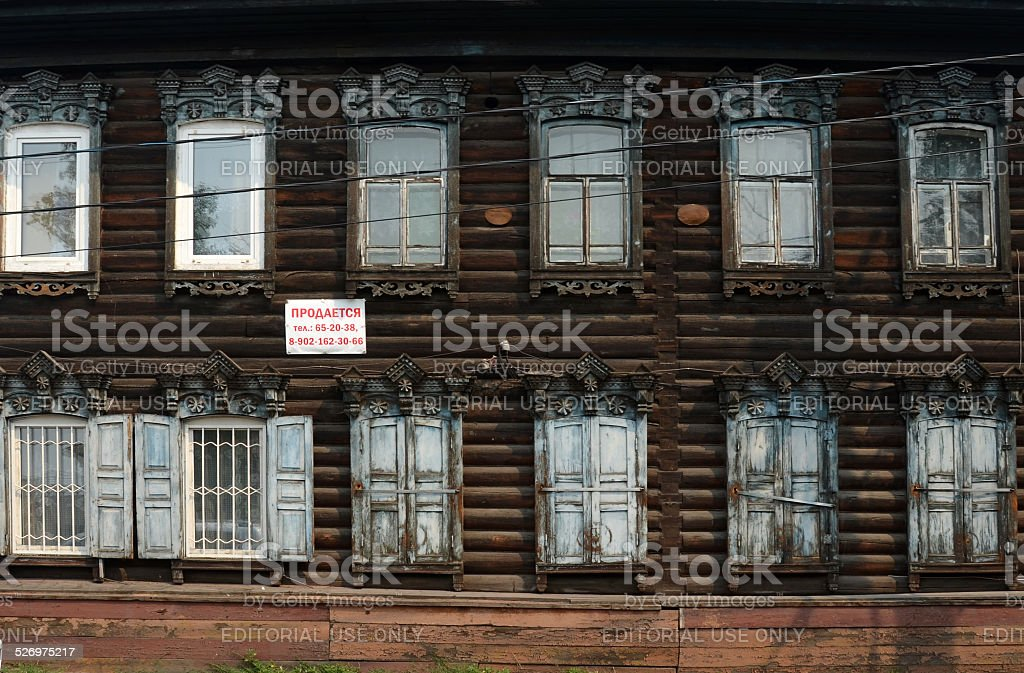 Wooden house in Siberia stock photo