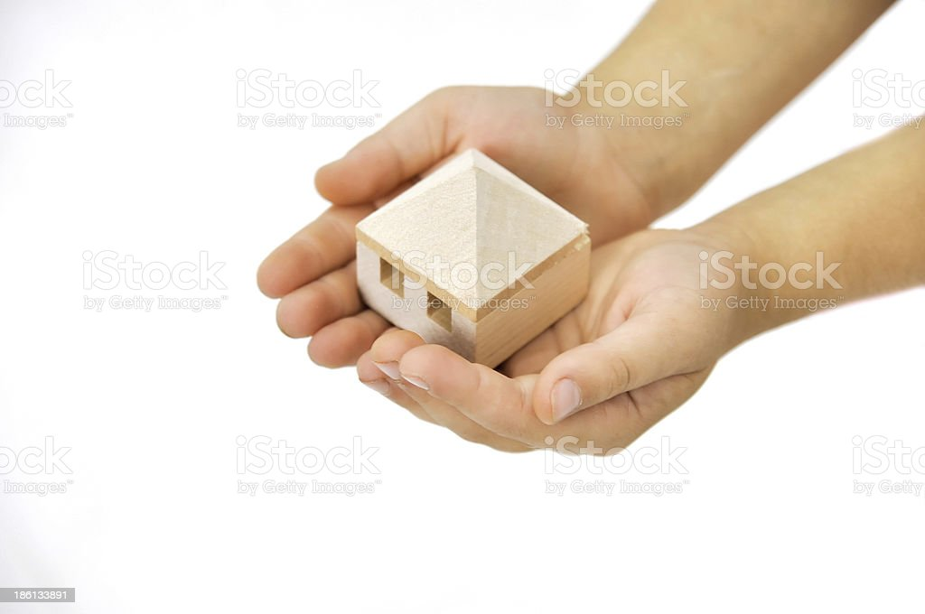 wooden house in the hand royalty-free stock photo