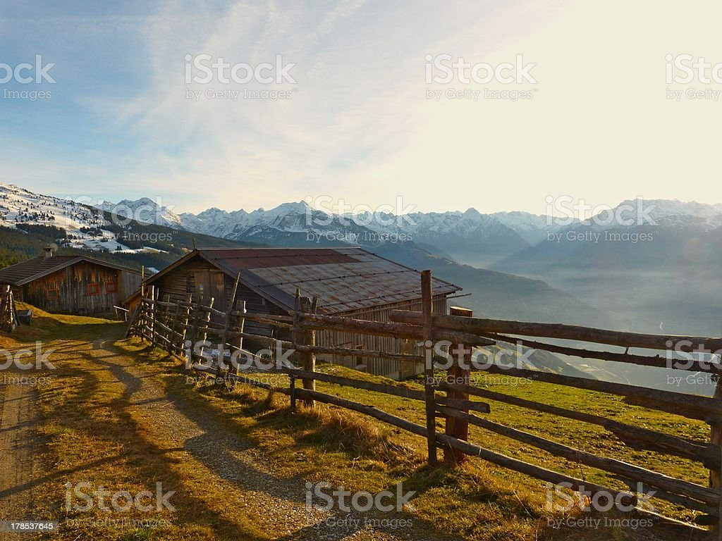 Wooden house in the mountains stock photo