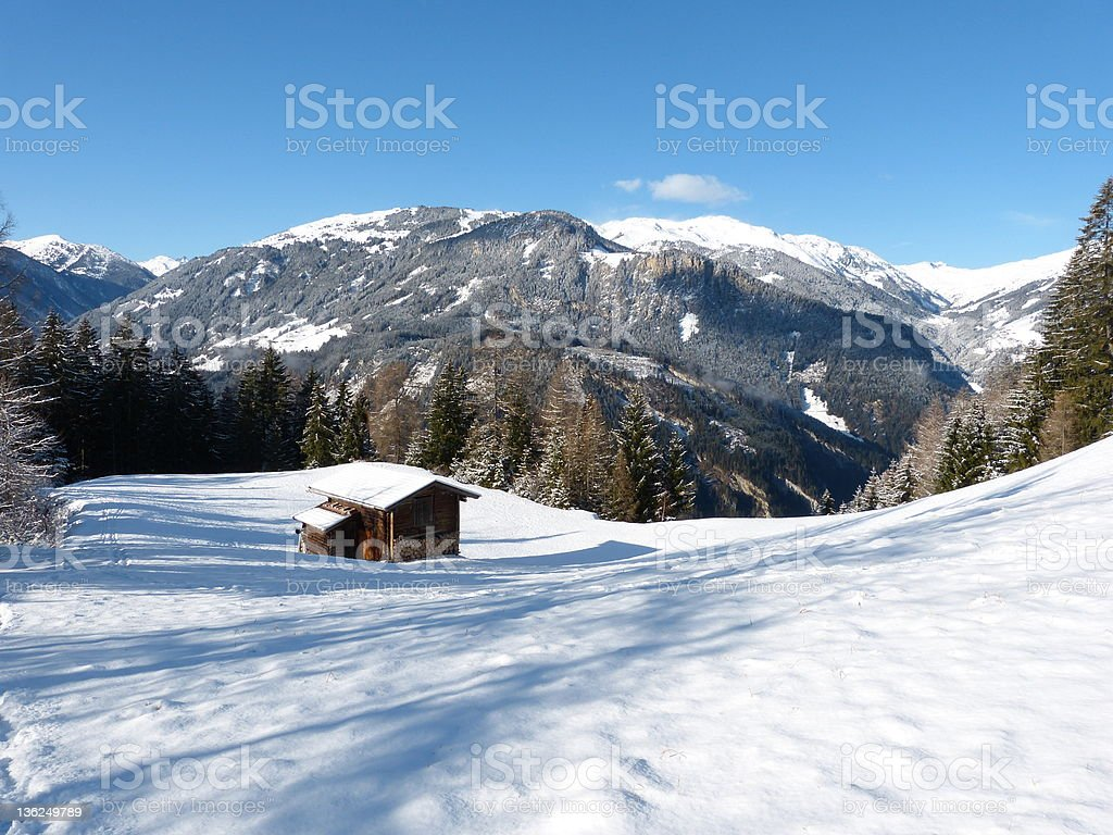 Wooden house in the snow stock photo