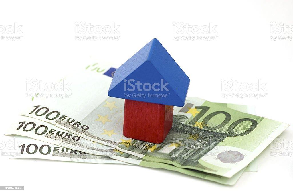 Wooden House on 100 Euro Bills stock photo