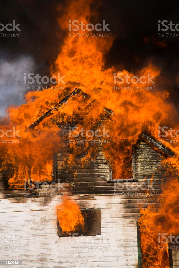 Wooden House on Fire royalty-free stock photo