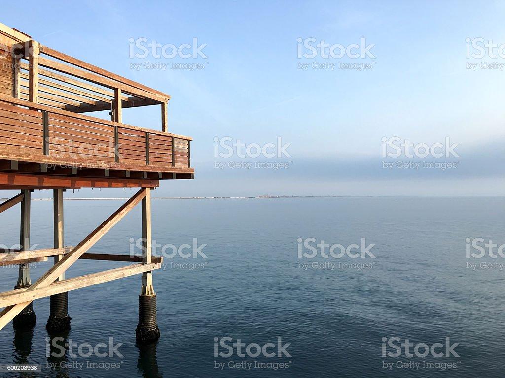 Wooden house on sea stock photo