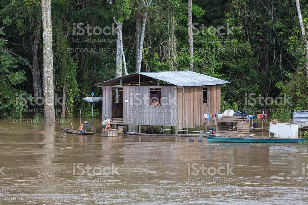 Wooden house on stilts along the Amazon river stock photo