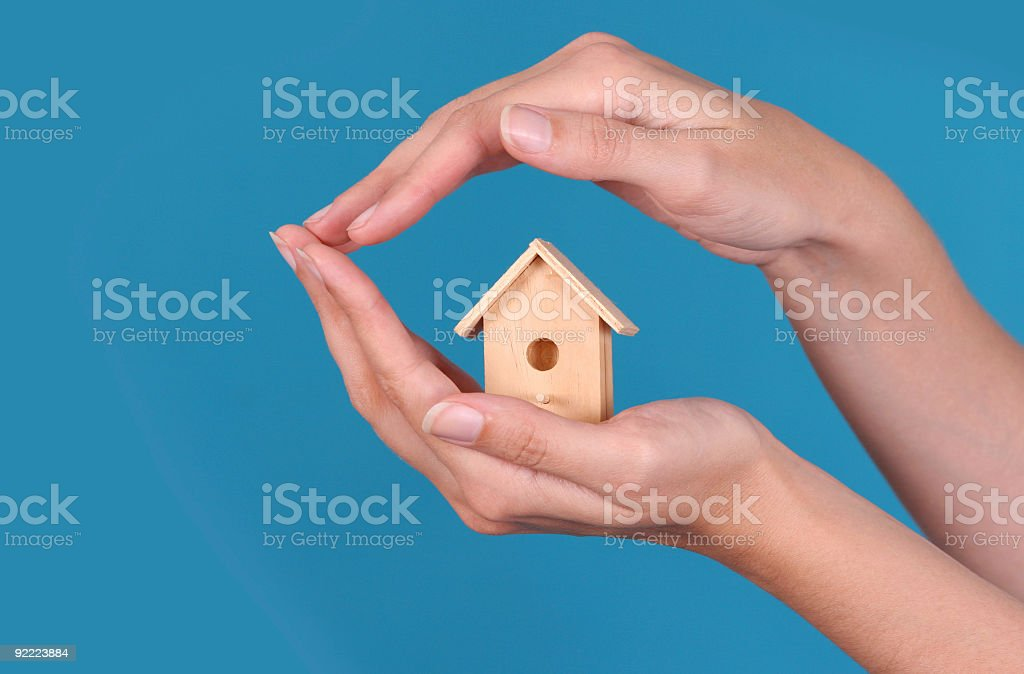 Wooden house on the hand royalty-free stock photo
