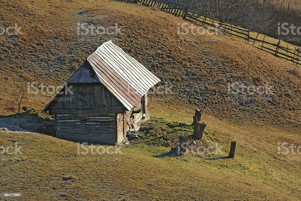 Wooden house on the hill royalty-free stock photo