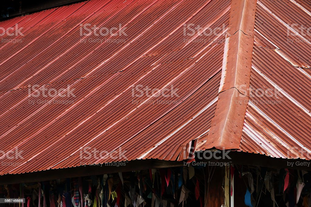 Wooden house tin roof , old rusty zinc roof stock photo