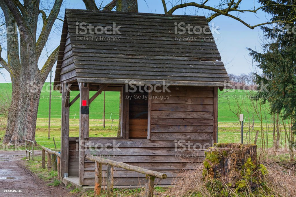 Wooden house to protect against wind and rain stock photo
