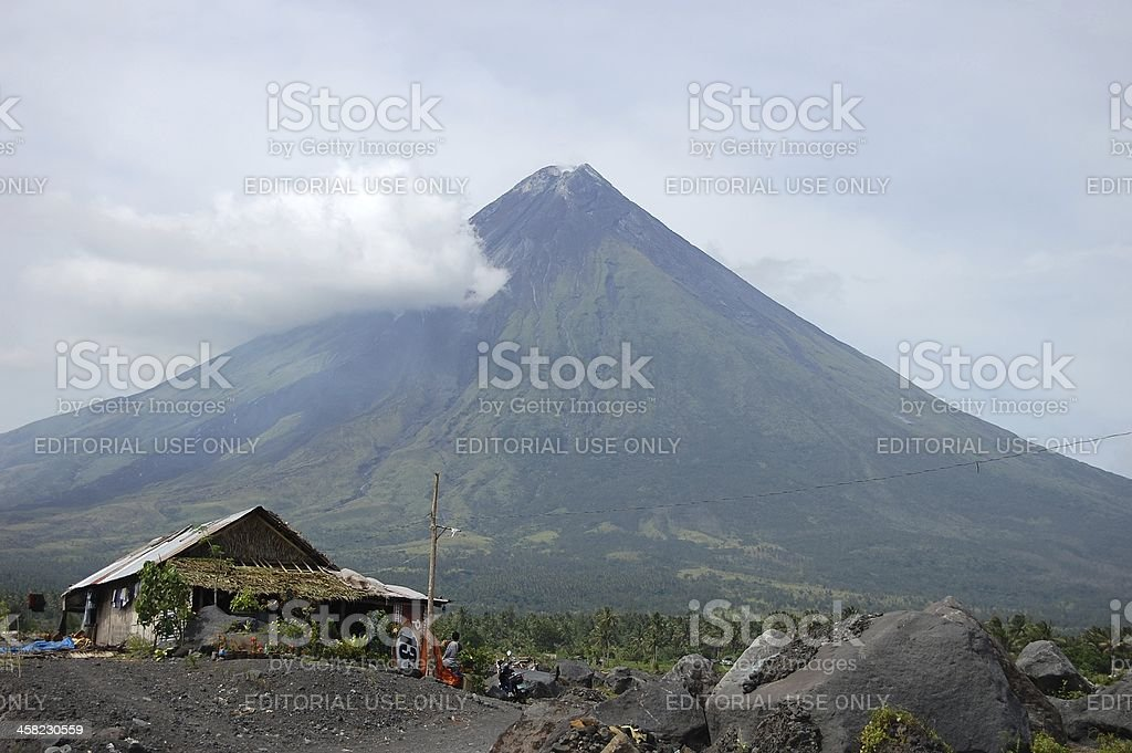 Wooden house under Mayon volcano's perfect cone, Albay Philippines stock photo