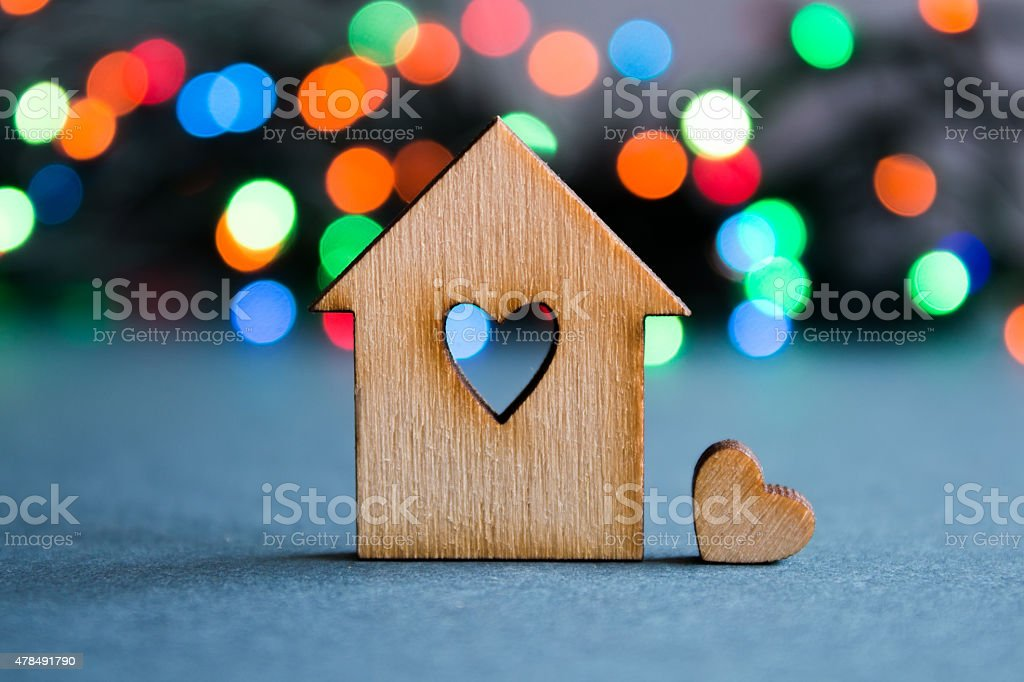 Wooden house with hole in the form of heart stock photo