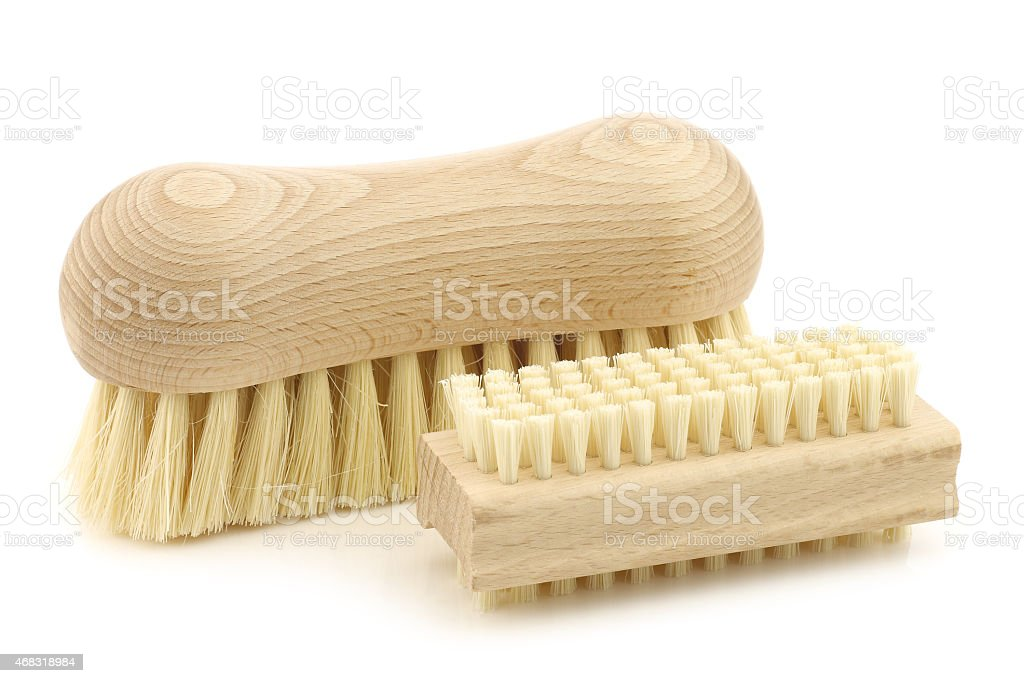 wooden household brush on a white background stock photo