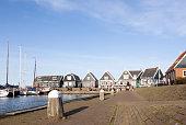 wooden houses at harbor of old dutch village Marken