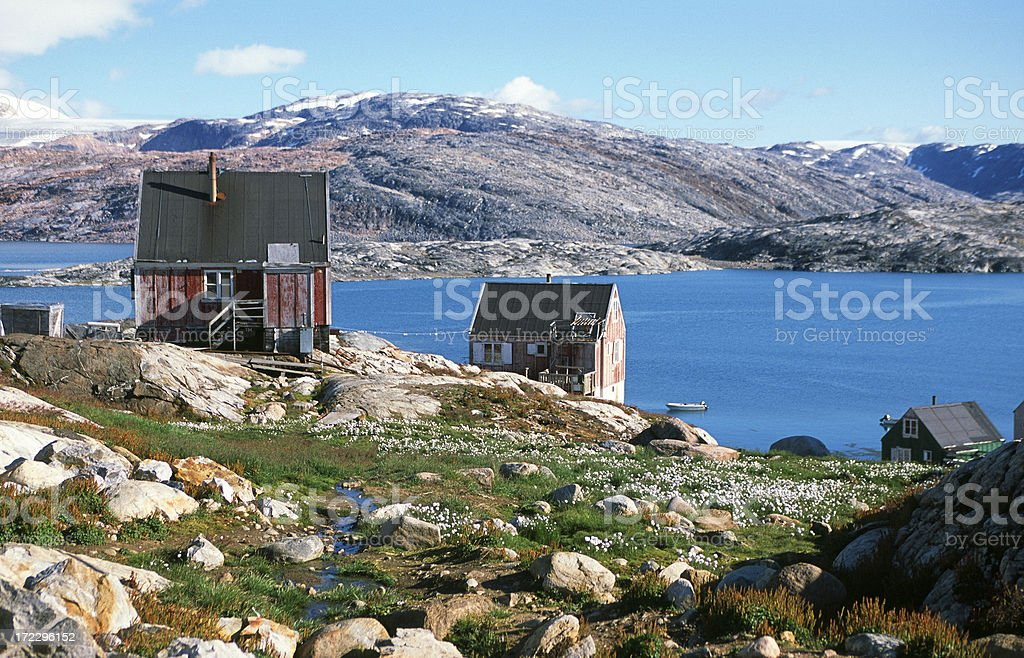 Wooden houses in Tinetiqilaaq, east Greenland royalty-free stock photo